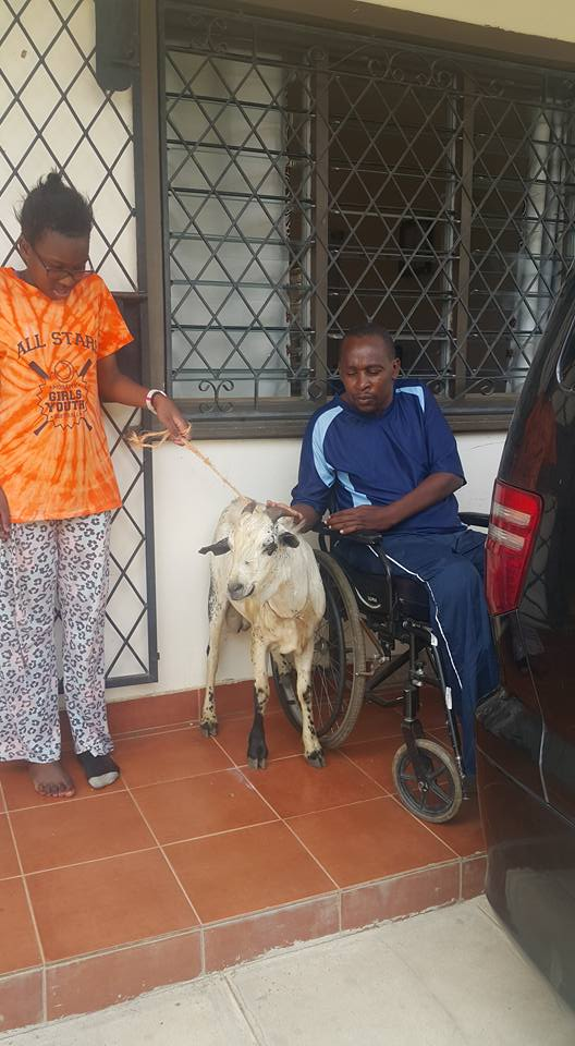 Richard Chacha giving his daughter Stacy her goat present   Facebook