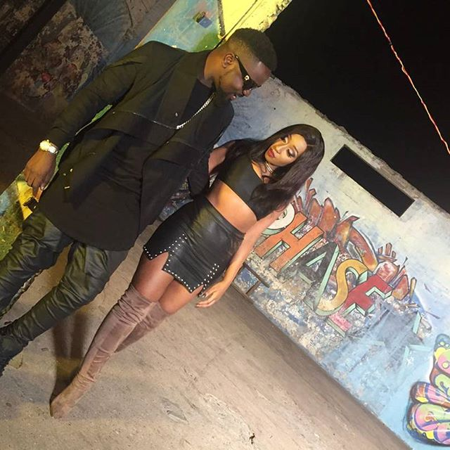 Sarkodie with Victoria Kimani at the set of 'giving you'