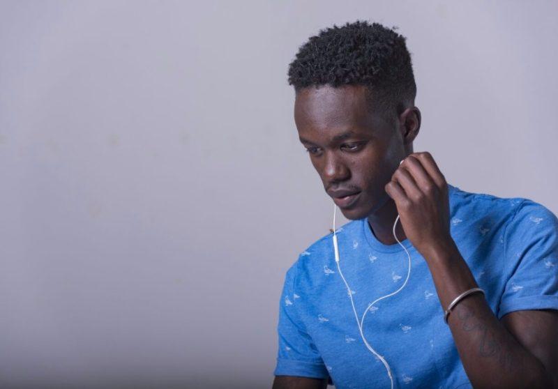 TC listening to ear phones