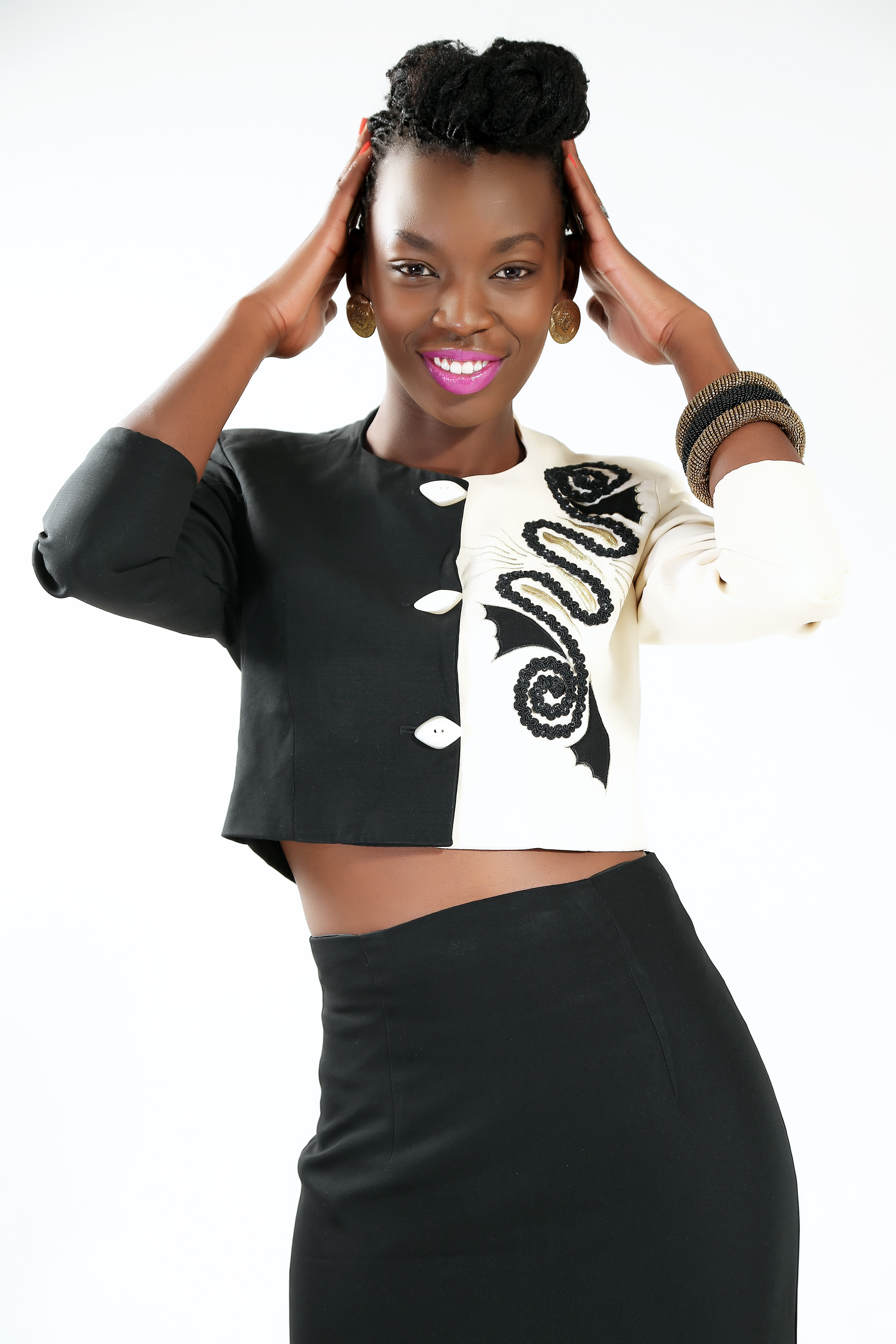 Anyiko Owoko in black and white attire