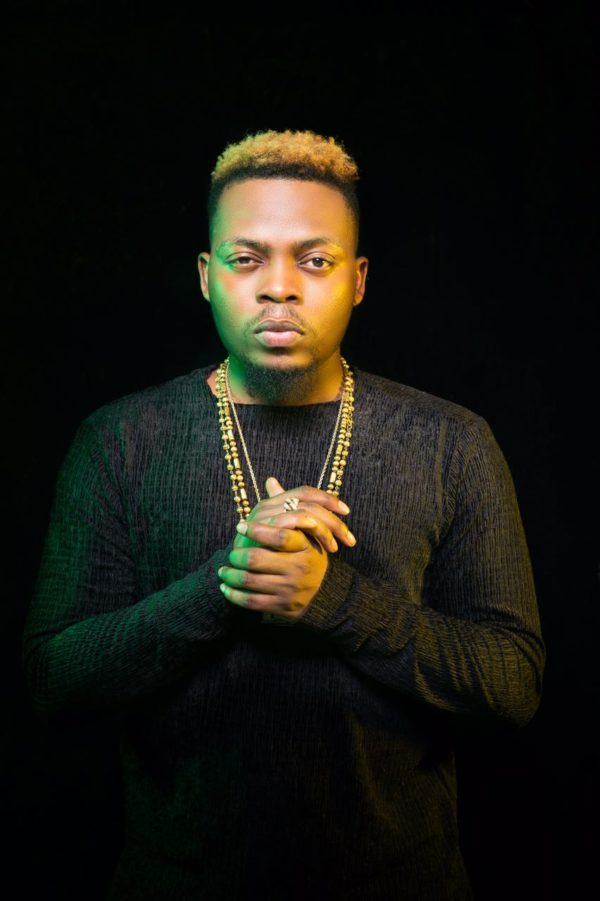 Olamide's praying hands photo