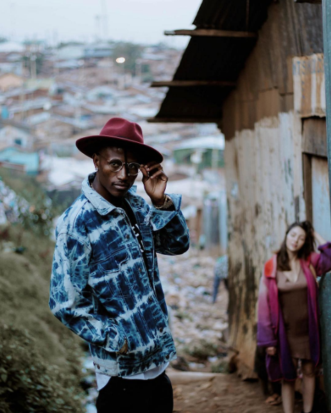 Octopizzo in Kibera with fiancee on the background