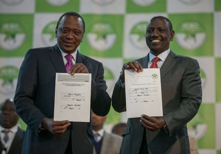 UHuru Kenyatta with William Ruto holding the certificate given by the IEBC