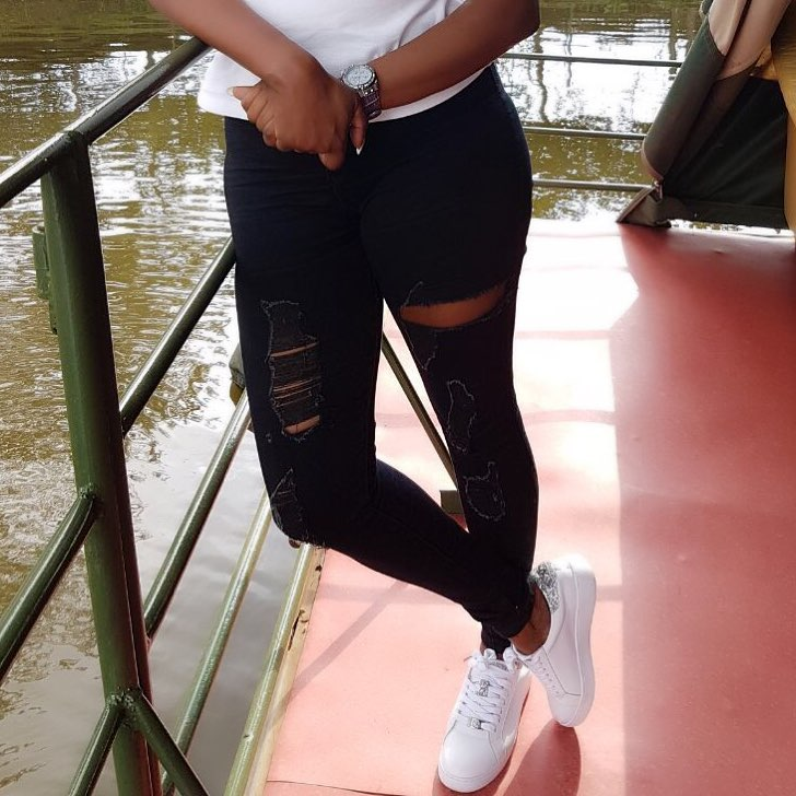 Lillian Muli's black torn jeans with white Stan Smiths sneakers