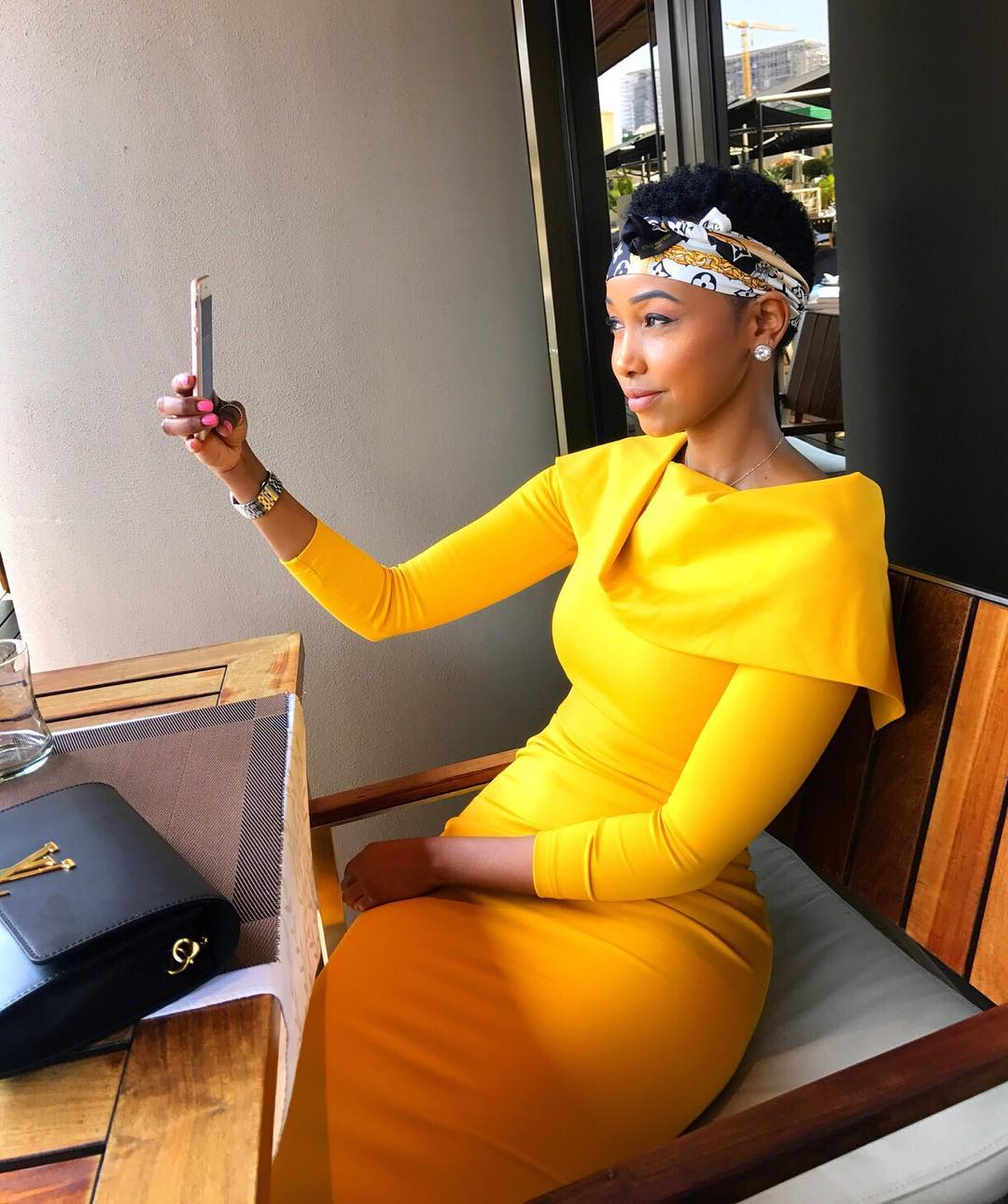 Huddah Monroe taking a selfie looking nice in her yellow off shoulder dress. Photo credit: Instagram/huddahthebosschick