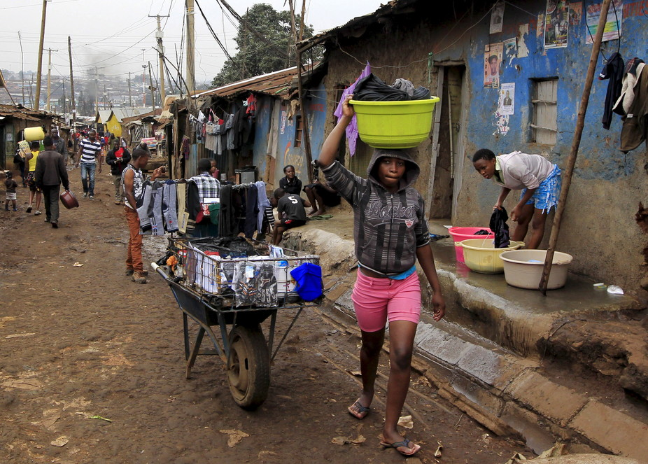 a girl carrying water basin on top of her head in Kibera. Phot credit: The Conversation