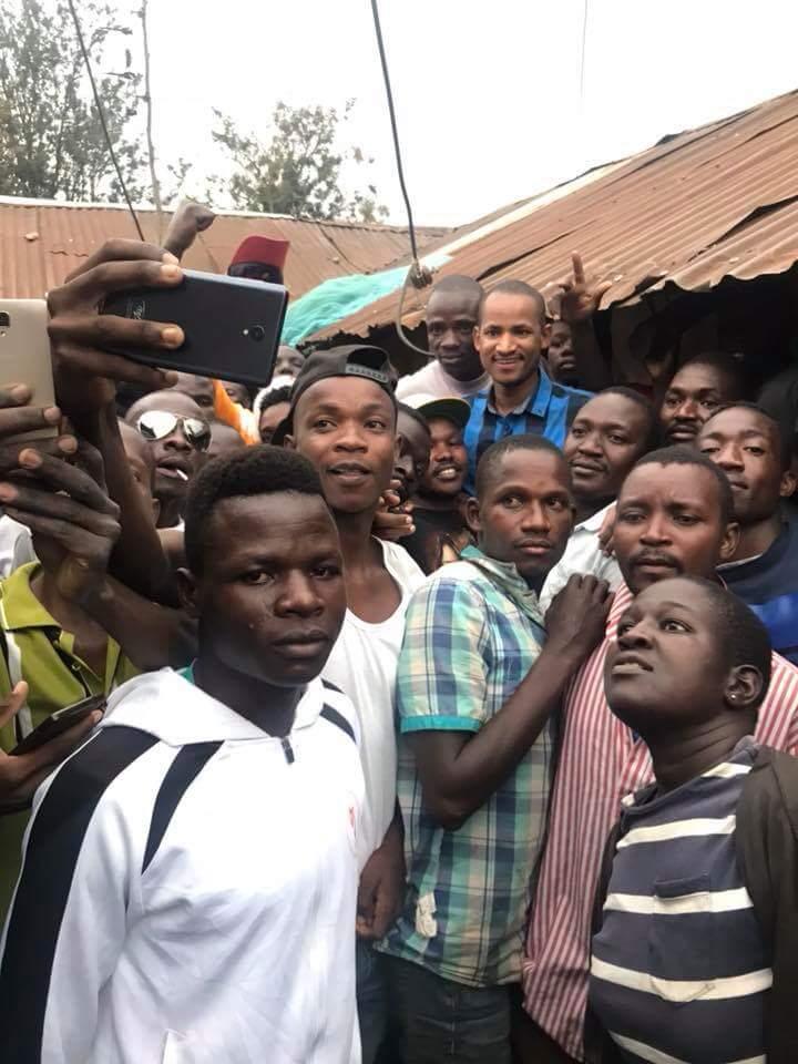 Babu Owino in Nyalenda posing for photos with his childhood friends in Kisumu. photo credit: Twitter/Babu_Owino