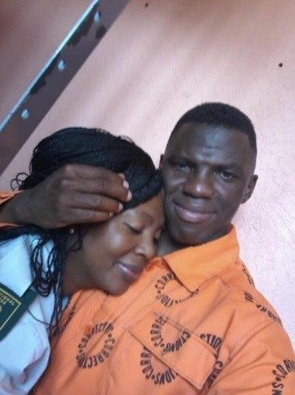 Deceased prison warden in a romantic posture with her lover