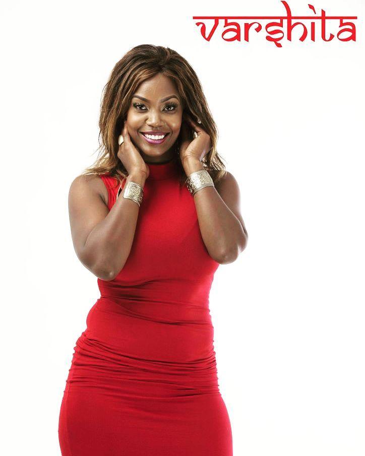Sanaipei Tande in red dress