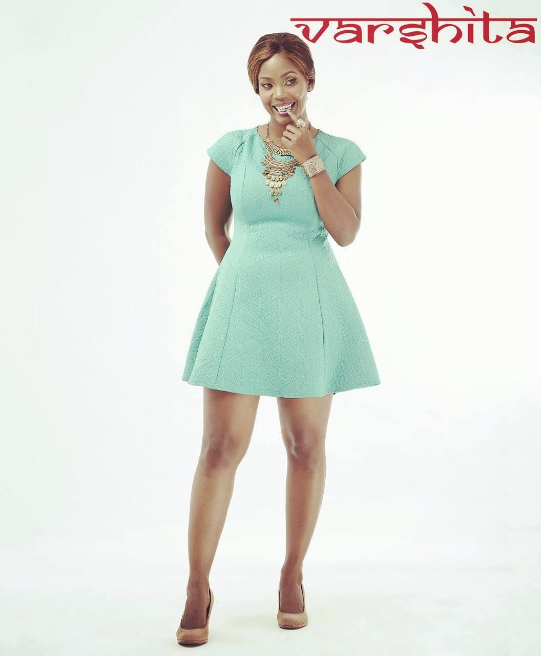 Sanaipei Tande in turquoise dress