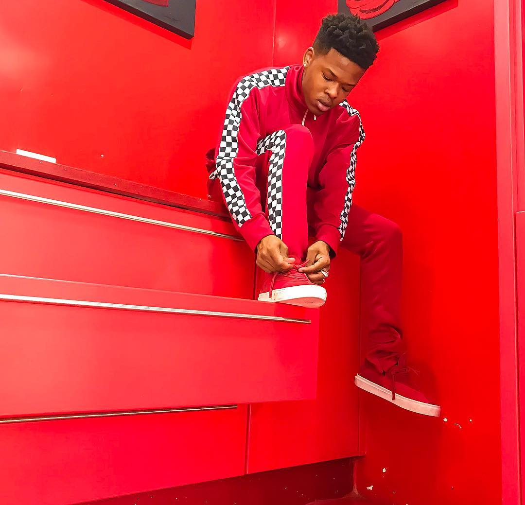 Nasty C posing in red tracksuit