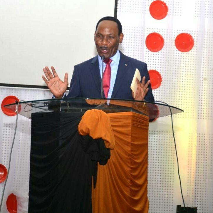 Ezekiel Mutua speaking on stage