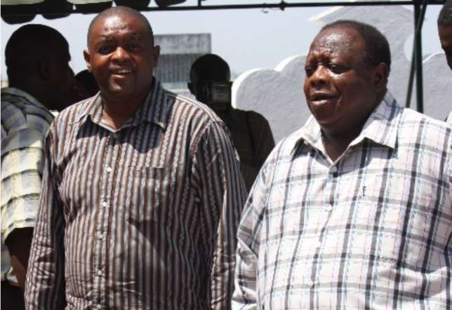 Seif Kajembe(left) with his father Ramadhan Kajembe(right). photo credit: courtesy