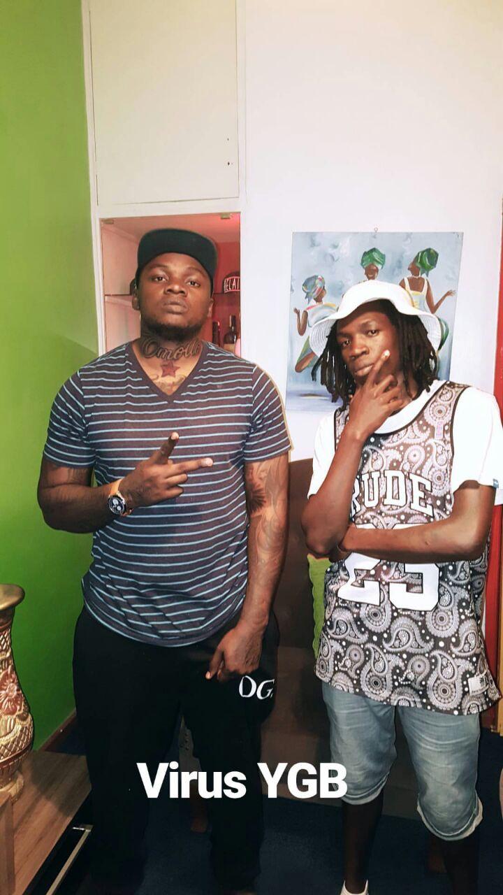 Khaligraph Jones showing off his 'Omollo' tattoo with Kibera rapper Virusi Mbaya. photo credit: Instagram/khaligraph_jones