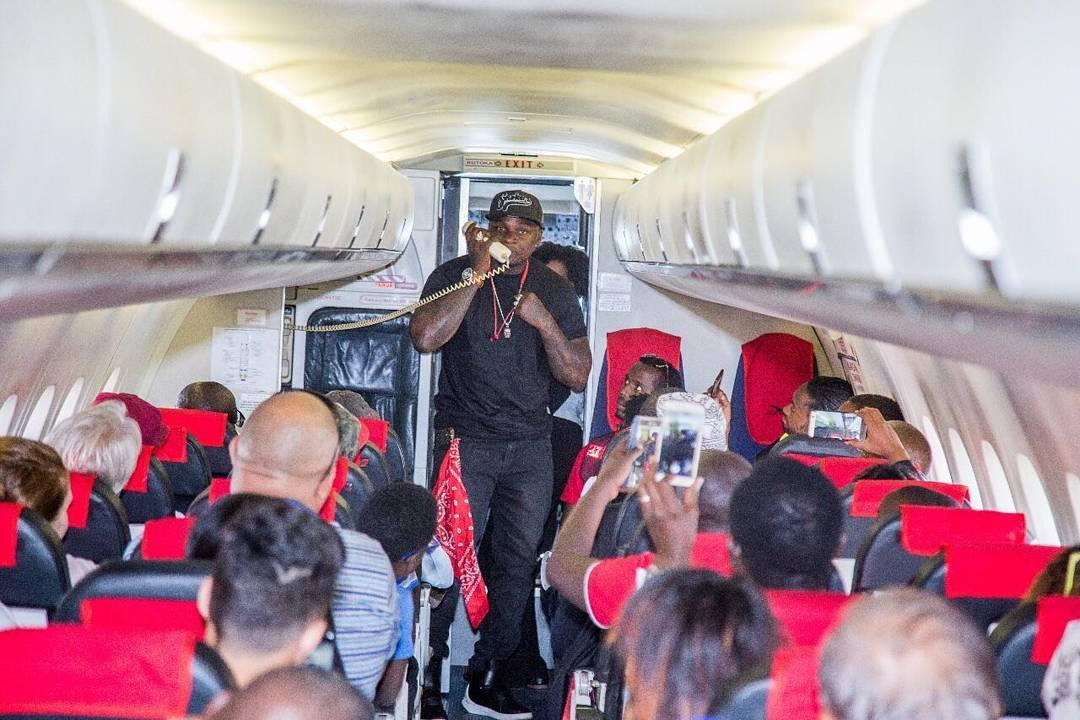 Khaligraph Jones speaking with Kenyans on aeroplane. photo credit: Instagram/khaligraph_jones