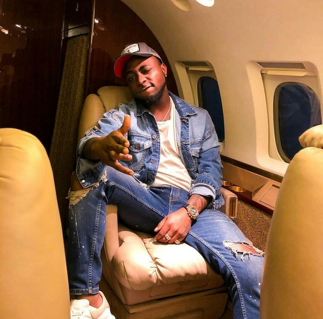 Davido taking a photo inside the jet on the right side of the seat. photo credit: courtesy