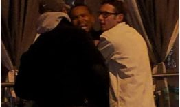 Chris Brown roughs up transgender woman outside gay club (Photos)