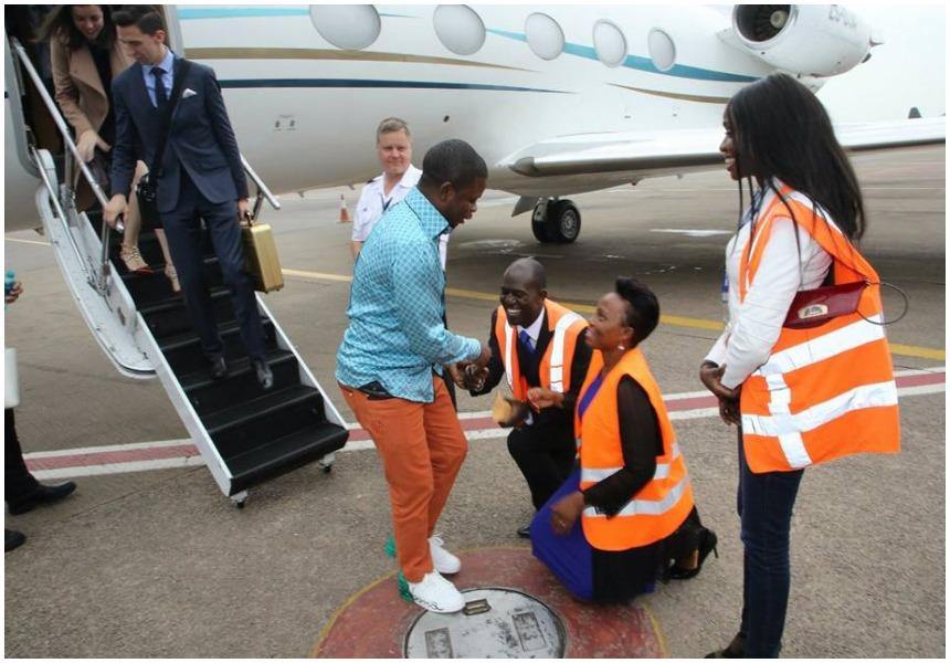 Ugandans kneel before Prophet Shepherd Bushiri when he touched down in Entebbe. Photo/Facebook